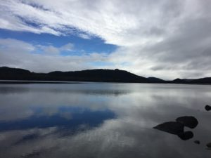 A bit of blue sky, after a cloudy day, over Nelson Lake on the south island of New Zealand